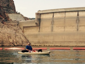 Sizing up the exposed dam. That spillway is a long way up there. East Canyon Res., Utah
